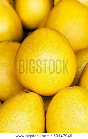 Pomelo Fruit Background. Pomelo Fruit On A Market Closeup. Citrus Background.