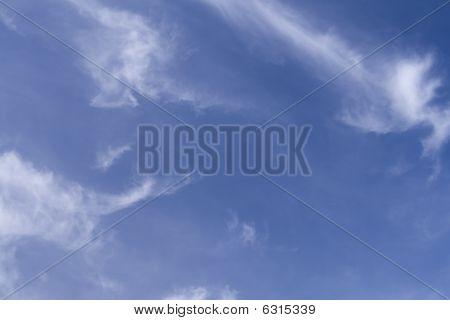 Fresh Clear Blue Sky With Wispy Clouds