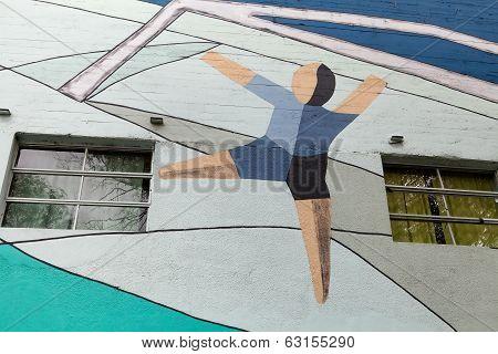 MONTEVIDEO, URUGUAY - MAR 19 2014 : A footballer mural on the exterior wall of the Centenario Stadiu