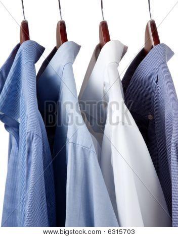 Blue Dress Shirts On Wooden Hangers
