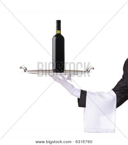Waiter holding a silver tray with a red wine