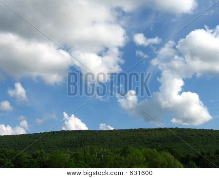 Green Field, Blue Sky And Clouds