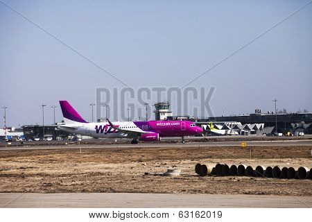 RIGA, LATVIA - APRIL 10, 2014: Wizz Air Airbus A320-232 after landing at Riga International Airport. Wizz Air is a Hungarian low-cost airline. From June 19 it will open new airbase in Riga.
