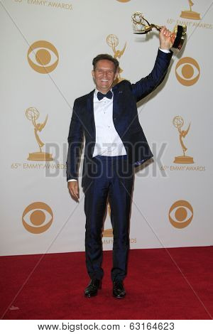 LOS ANGELES - SEP 22: Mark Burnett in the press room during the 65th Annual Primetime Emmy Awards held at Nokia Theater L.A. Live on September 22, 2013 in Los Angeles, California