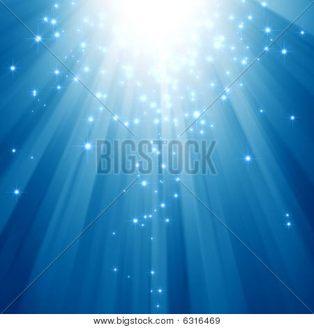 Blue light beams with glitter stars