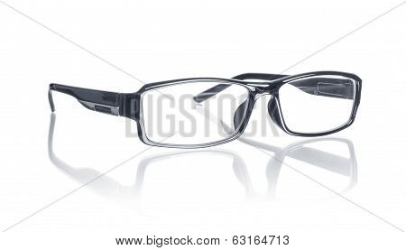 Modern glasses with reflection over white background
