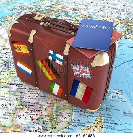 Old Suitcase With Passports And Striples Flags On World Map Background