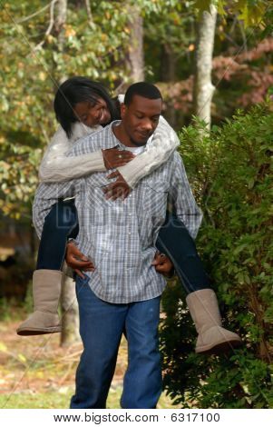 African-american Couple riding piggyback