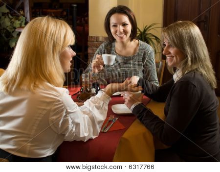 Beautiful Girls Chatting At Tea