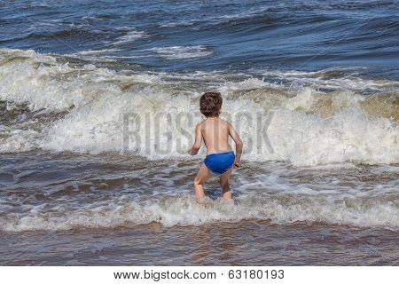 Kid Playing On A Beach