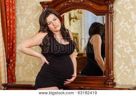 Pregnant Woman Feeling Pain In Her Back.