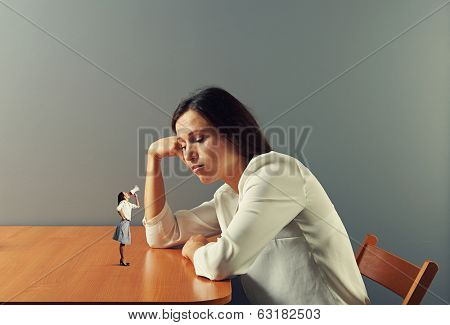 small woman urging on tired businesswoman