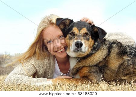 Smiling Woman Hugging German Shepherd Dog