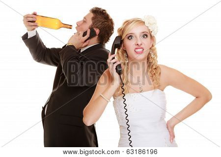 Wedding. Angry Bride And Groom Talking On Phone