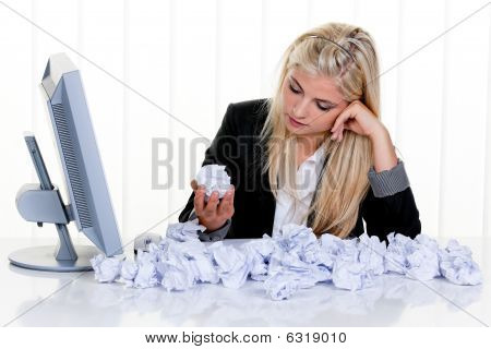 Woman Surrounded By Crumpled Paper