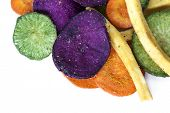 Vegetable crisps, isolated.  Healthy snack food.