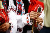 picture of bagpipes  - Color shot of a person holding a traditional Romanian bagpipe - JPG