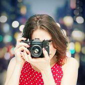 Beautiful Girl With Vintage Photo Camera On Night  Background In Soft Focus