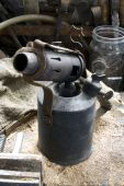 stock photo of blow torch  - Old Blow lamp on workbench parafin blow torch for removing paint - JPG
