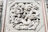 Facade of a stone carving of a dragon