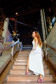 Attractive Woman On A Stairway Inside A Building