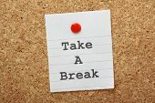 foto of breather  - The phrase Take A Break typed on a paper note and pinned to a cork notice board - JPG