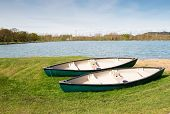 Two canoes on grass bank
