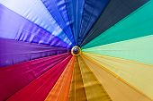 outside part of an umbrella with all rainbow colours