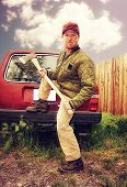 a redneck man with an ax in his hands done with a warm filter