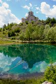 Church With Reflection In Beautiful Turquoise Lake