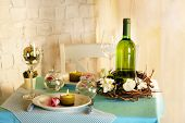 Beautiful holiday Easter table setting in blue tones, on light background
