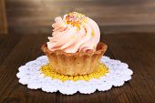 Tasty cake on table on wooden background