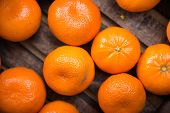 picture of mandarin orange  - Organic Mandarin Oranges in Dark Wooden Crate - JPG