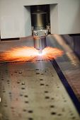 Industrial Laser cutting of steel metal sheet with sparks