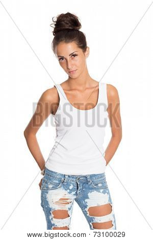 Charming young girl in jeans and a white T-shirt. Isolation on a white background.