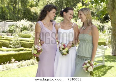 Bride With Two Women In Garden, Holding Bouquets, Smiling, Portrait