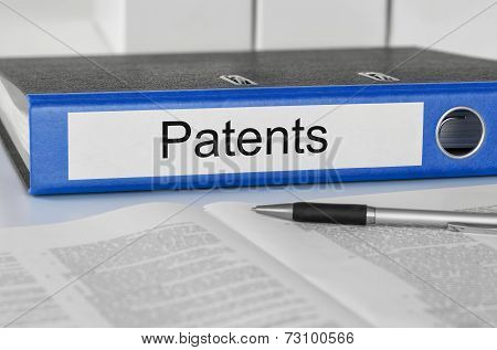 A blue folder with the label Patents