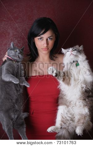 Young woman holding her cats