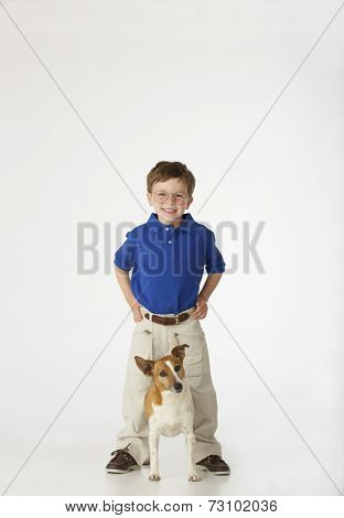 Boy standing with dog