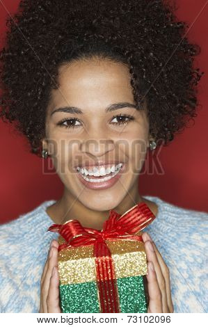 Young woman holding gift