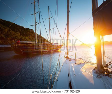 Sail boats anchored in a calm blue water bay of Skopea Limani. Turkey