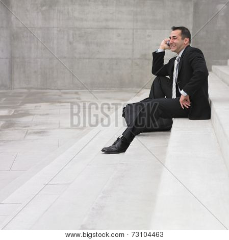 Businessman sitting while talking on cell phone