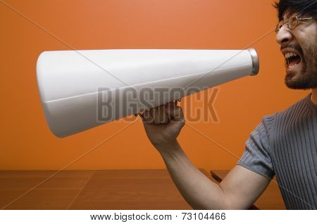 Man yelling into megaphone