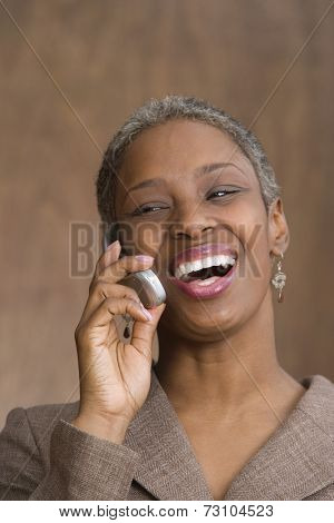 Mid adult business woman talking on cell phone