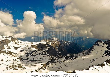 Alps Mountain Landscape with Clouds