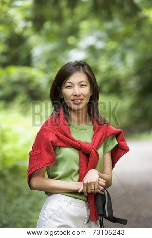 Portrait of woman with walking stick