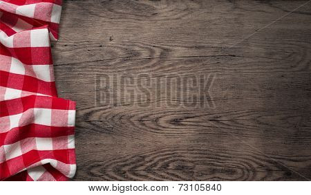 picnic tablecloth on old wooden table top view