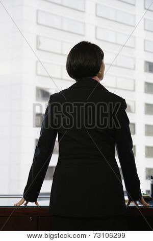Businesswoman gazing out window