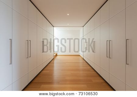 interior of a modern house, long corridor with wardrobes