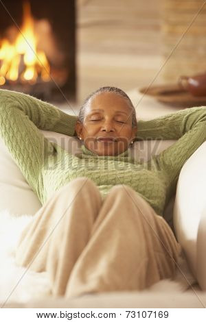 Senior African woman relaxing on the sofa